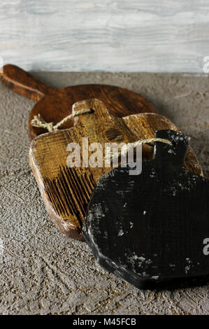 Wooden cutting boards on grey concrete background. Props for food photography - Stock Photo