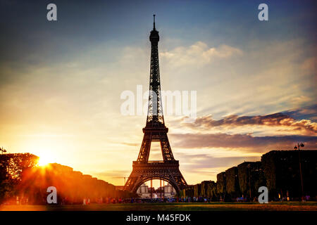 Eiffel Tower seen from Champ de Mars at sunset - Stock Photo