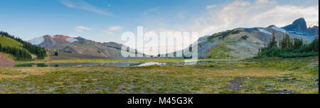 Camping behind black tusk - Stock Photo