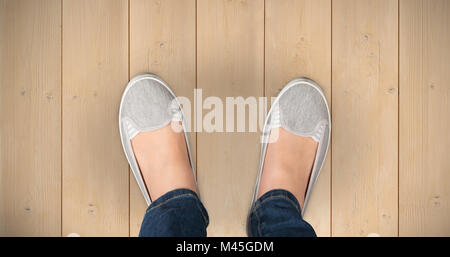 Composite image of casually dressed womans feet - Stock Photo