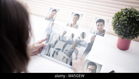 Composite image of business people having a meeting - Stock Photo