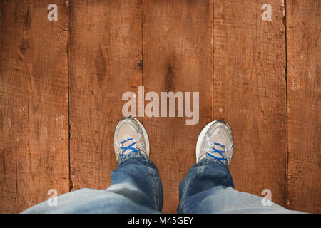 Composite image of casually dressed mans feet - Stock Photo