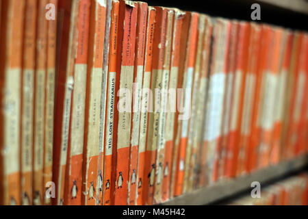 Penguin books for sale in a second-hand bookshop - Stock Photo