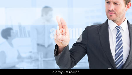 Composite image of businessman pointing with his finger - Stock Photo