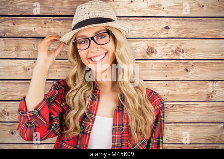 Composite image of gorgeous smiling blonde hipster posing