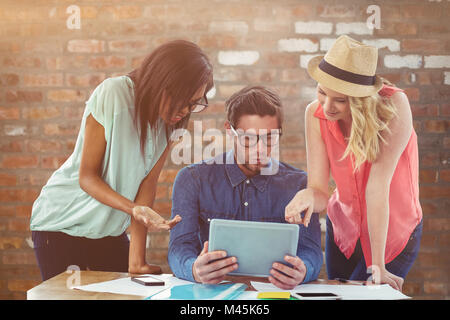 Composite image of creative business team working hard together - Stock Photo