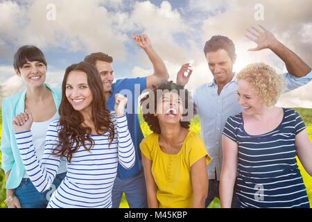 Composite image of creative business team having fun - Stock Photo