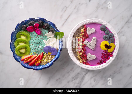 Acai bowl smoothie and Spirulina algae healthy breakfast with seeds and berries - Stock Photo