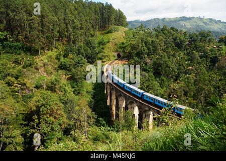Train on the Nine Arches Bridge in the highlands near Ella,Sri Lanka - Stock Photo