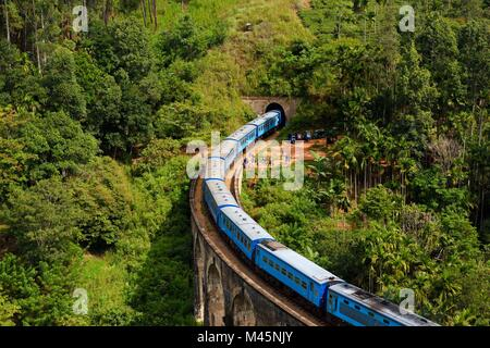 Train on the Nine Arches Bridge in the highlands near Ella,Sri Lanka - Stock Photo