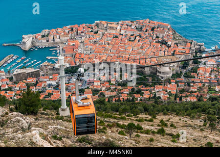 Aerial view of the old town with cable car, Dubrovnik, Croatia - Stock Photo