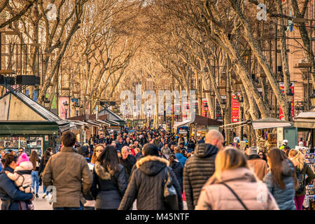 Tourists strolling on the famous Rambla pedestrian mall, Barcelona, Catalonia, Spain - Stock Photo