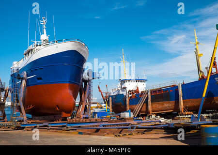 Trawlers at the dry dock seen in Reykjavik, Icelan - Stock Photo