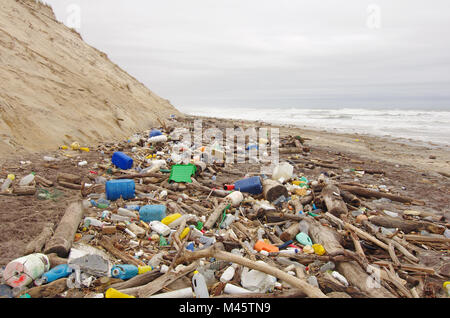 garbage, plastic, and wastes on the beach after winter storms. - Stock Photo