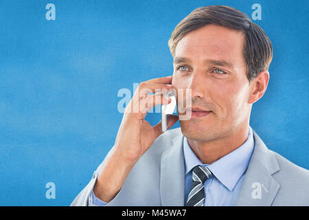 Composite image of business man having phone call - Stock Photo