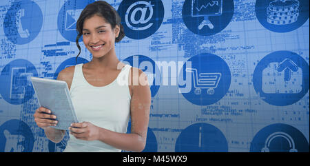 Composite image of portrait of smiling businesswoman using tablet computer - Stock Photo