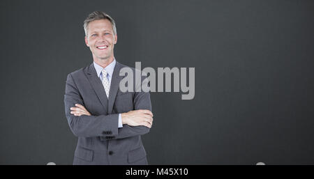 Composite image of portrait of smiling businessman standing arms crossed - Stock Photo