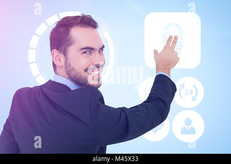Composite image of smiling businessman pointing these fingers - Stock Photo