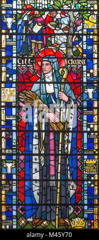 LONDON, GREAT BRITAIN - SEPTEMBER 16, 2017: The St. Brigid of Kildare on the stained glass in church St Etheldreda - Stock Photo