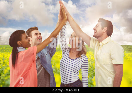 Composite image of happy creative team giving a motivational gesture - Stock Photo