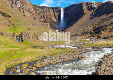 The Hengifoss waterfall in Iceland in the distance - Stock Photo