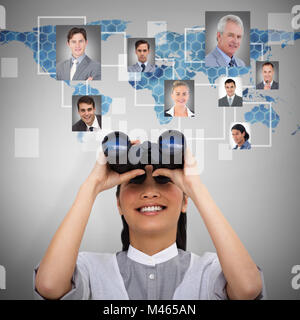 Composite image of visionary businesswoman looking through binoculars - Stock Photo