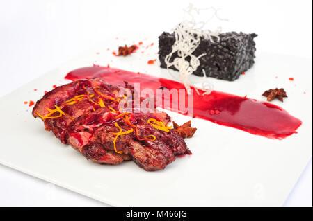 Steak Ribeye on white plate - Stock Photo
