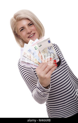 Smiling woman holding a handful of Euro notes - Stock Photo