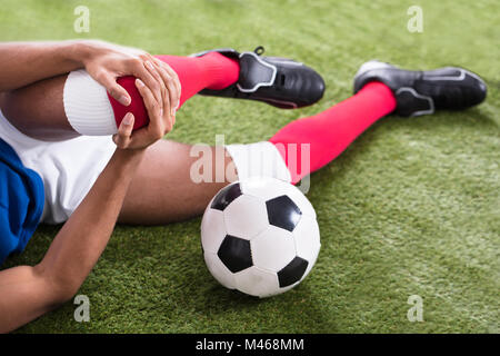 Close-up Of An Injured Male Soccer Player On Field - Stock Photo