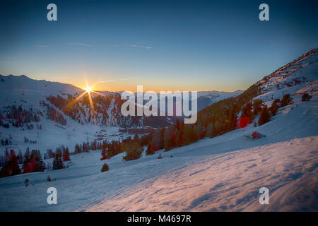 Winter sunset landscape at Belle Plagne ski resort in La Plagne, Savoie, France. Credit: Malcolm Park/Alamy. - Stock Photo