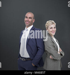 Composite image of  smiling business people back-to-back - Stock Photo