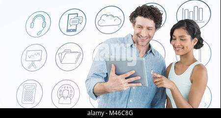 Composite image of smiling business people using digital tablet - Stock Photo