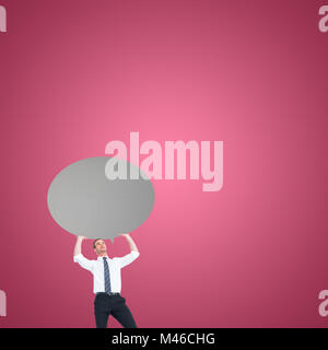 Composite image of businessman holding a speech bubble - Stock Photo