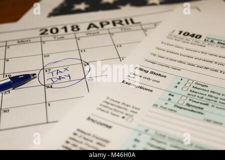 Calendar and form 1040 income tax form for 2017 showing tax day for filing is April 17 2018 - Stock Photo