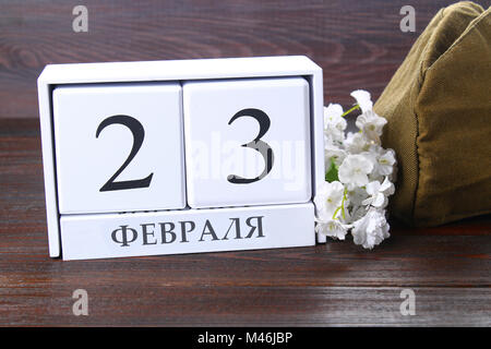 White calendar with Russian text: February 23. Holiday is the day of the defender of the fatherland - Stock Photo