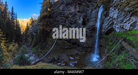 Panoramic view of the Arpiglia Waterfall during autumn. Val Arpiglia, Zuoz, Engadine, Graubünden, Switzerland. - Stock Photo