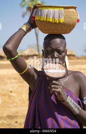 Mursi woman with labial plate, ethnic minorities of the lower Omo valley - Ethiopia. © Antonio Ciufo - Stock Photo