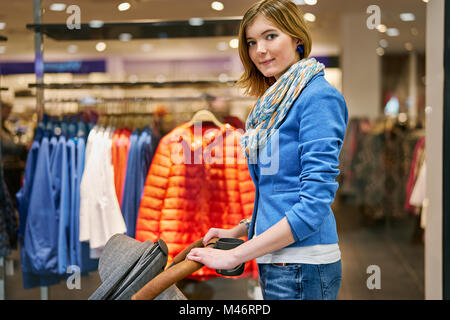 Young woman during shopping - Stock Photo