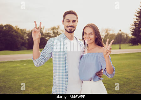 Attractive gorgeous cute sweet brunet and brunette partners with beaming grins, posing outside, well dressed, so - Stock Photo