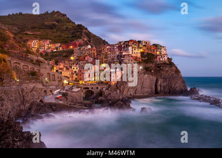The medieval village of Manarola in The Cinque Terre, Liguria, Italy - Stock Photo