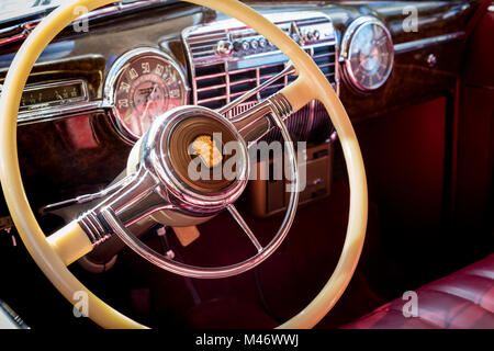 Front dash and steering wheel of a 1941 Cadillac on display at 'Cars on 5th' autoshow, Naples, Florida, USA - Stock Photo