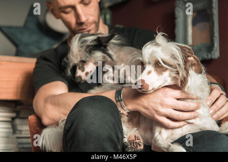 Love between a man and his dog - Stock Photo