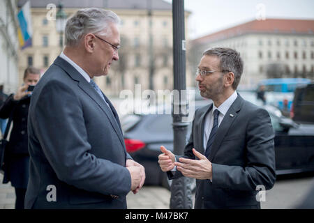 Munich, Germany. 15th Feb, 2018. Joachim Herrmann (CSU, L), Minister of Interior of the state of Bavaria, receiving - Stock Photo