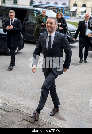 Munich, Germany. 15th Feb, 2018. Herbert Kickl (FPO), Austrian Minister of Interior, walking up to the gate of the - Stock Photo