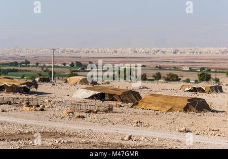 Bedouin houses in the desert near Dead Sea - Stock Photo