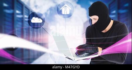 Composite image of focused burglar standing holding laptop - Stock Photo