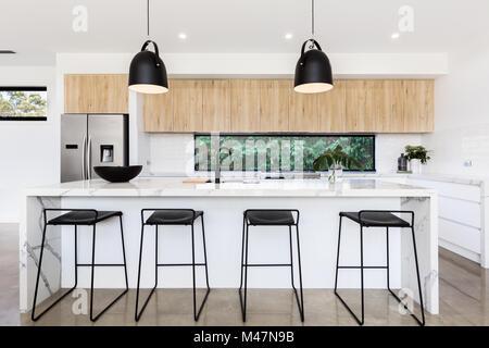 Large luxury Australian kitchen with marble island bench - Stock Photo
