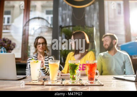 Beautiful colorful hot teas on the table - Stock Photo