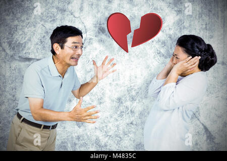 Composite image of older asian couple having an argument - Stock Photo