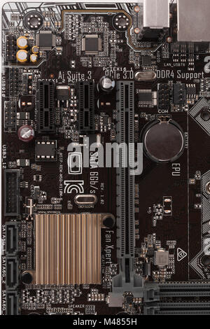 Slot for graphic card on new, office motherboard, close up view. - Stock Photo